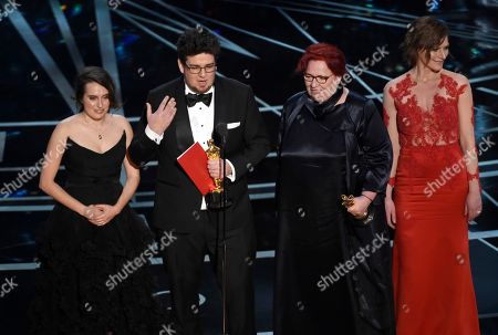 """Nina Kov, from left, Kristof Deak, Anna Udvardy and Zsofia Szamosi accepts the award for best live-action short film for """"Sing"""" at the Oscars, at the Dolby Theatre in Los Angeles"""