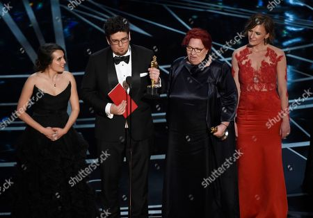 "Nina Kov, from left, Kristof Deak, Anna Udvardy and Zsofia Szamosi accepts the award for best live-action short film for ""Sing"" at the Oscars, at the Dolby Theatre in Los Angeles"