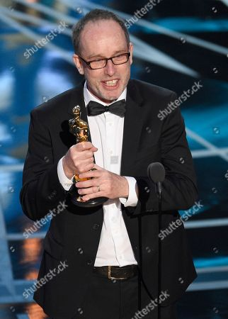 "John Gilbert accepts the award for best film editing for ""Hacksaw Ridge"" at the Oscars, at the Dolby Theatre in Los Angeles"