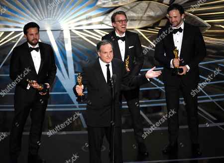 """Adam Valdez, from left, Robert Legato, Andrew R. Jones, and Dan Lemmon accept the award for best visual effects for """"The Jungle Book"""" at the Oscars, at the Dolby Theatre in Los Angeles"""