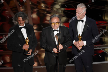 """Giorgio Gregorini, from left, Alessandro Bertolazzi, and Christopher Allen Nelson accept the award for best makeup and hairstyling for """"Suicide Squad"""" at the Oscars, at the Dolby Theatre in Los Angeles"""