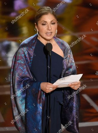 "Anousheh Ansari accepts the award for best foreign language film for ""The Salesman"" on behalf of Asghar Farhadi at the Oscars, at the Dolby Theatre in Los Angeles"