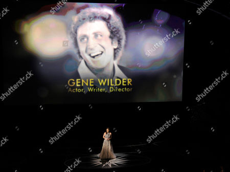 Sara Bareilles performs during an In Memoriam tribute at the Oscars, at the Dolby Theatre in Los Angeles. Gene Wilder is pictured on screen