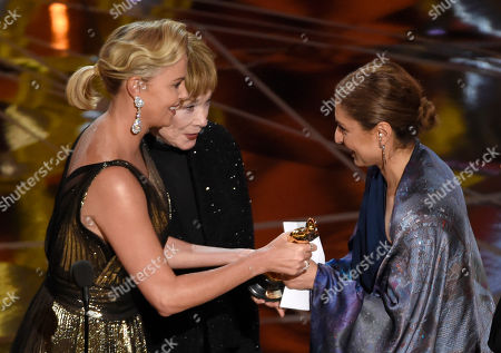 "Charlize Theron, left, and Shirley MacLaine, present the award for best foreign language film to Anousheh Ansari on behalf of Asghar Farhadi for ""The Salesman"" at the Oscars, at the Dolby Theatre in Los Angeles"