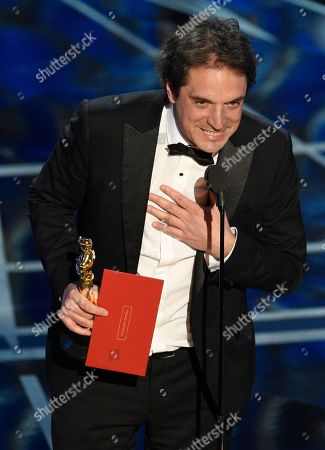 """Sylvain Bellemare accepts the award for best sound editing for """"Arrival"""" at the Oscars, at the Dolby Theatre in Los Angeles"""