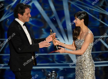 """Sofia Boutella, right, presents Sylvain Bellemare with the award for best sound editing for """"Arrival"""" at the Oscars, at the Dolby Theatre in Los Angeles"""