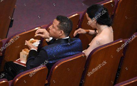 Terrence Howard, left, and Miranda Pak in the audience at the Oscars, at the Dolby Theatre in Los Angeles