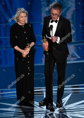 """Sandy Reynolds-Wasco, left, and David Wasco accept the award for best production design for """"La La Land"""" at the Oscars, at the Dolby Theatre in Los Angeles"""
