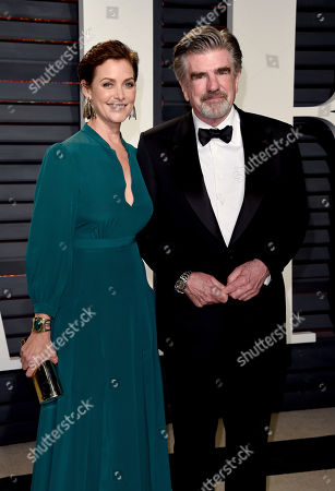 Carey Lowell, left, andTom Freston arrive at the Vanity Fair Oscar Party, in Beverly Hills, Calif