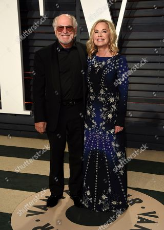 Jimmy Buffett, left, and Jane Slagsvol arrive at the Vanity Fair Oscar Party, in Beverly Hills, Calif