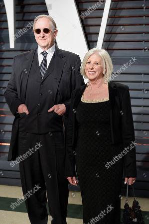 T Bone Burnett, left, and Callie Khouri arrive at the Vanity Fair Oscar Party, in Beverly Hills, Calif