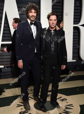 Jorn Weisbrodt, left, and Rufus Wainwright arrive at the Vanity Fair Oscar Party, in Beverly Hills, Calif