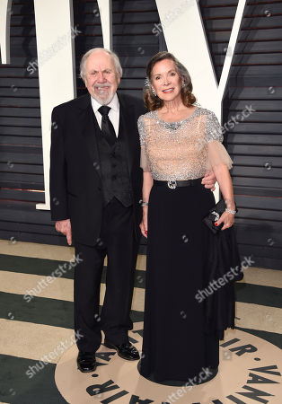 Producer George Schlatter, left, and actress Jolene Brand arrive at the Vanity Fair Oscar Party, in Beverly Hills, Calif