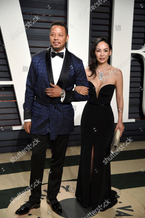Terrence Howard, left, and Miranda Pak arrive at the Vanity Fair Oscar Party, in Beverly Hills, Calif