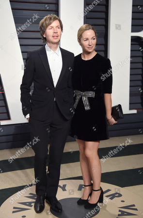 Beck, left, and Marissa Ribisi arrive at the Vanity Fair Oscar Party, in Beverly Hills, Calif