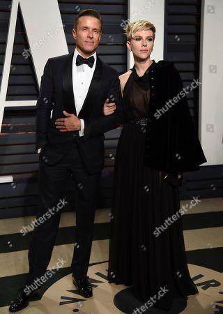 Joe Machota, left, Scarlett Johansson arrive at the Vanity Fair Oscar Party, in Beverly Hills, Calif