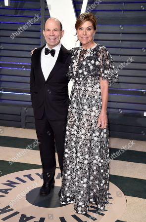 Steven Newhouse, left, and Gina Sanders arrive at the Vanity Fair Oscar Party, in Beverly Hills, Calif