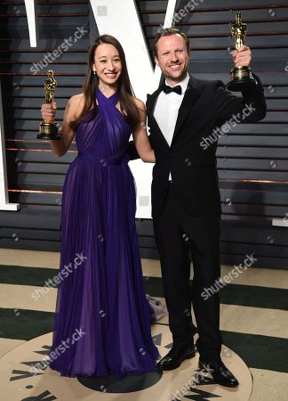 Joanna Natasegara, left, and Orlando von Einsiedel arrive at the Vanity Fair Oscar Party, in Beverly Hills, Calif