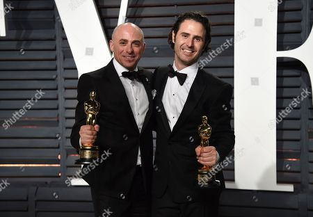 Marc Sondheimer, left, and Alan Barillaro arrive at the Vanity Fair Oscar Party, in Beverly Hills, Calif