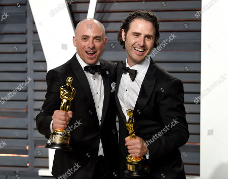 Stock Picture of Marc Sondheimer, left, and Alan Barillaro arrive at the Vanity Fair Oscar Party, in Beverly Hills, Calif