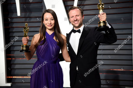 Joanna Natasegara and Orlando von Einsiedel arrive at the Vanity Fair Oscar Party, in Beverly Hills, Calif