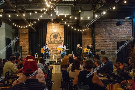 Ashley Gorley, from left, Darrell Worley, and Jamie O'Neal seen at An Evening in the Songwriters Round benefiting the Tug McGraw Foundation at The Listening Room, in Nashville, Tenn
