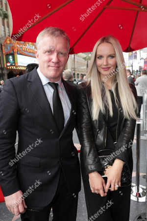 Stock Photo of Anthony Michael Hall and Lucia Oskerova seen at Brett Ratner honored with a star on the Hollywood Walk of Fame, in Los Angeles