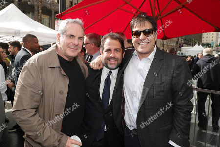Stock Image of Roger Birnbaum, Brett Ratner and Jonathan Glickman, President of the Motion Picture Group for Metro-Goldwyn-Mayer Studios, seen at Brett Ratner honored with a star on the Hollywood Walk of Fame, in Los Angeles