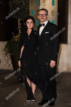 Maureen Pegg and Simon Pegg pose for photographers upon arrival at the BAFTA Film Awards after party, in London