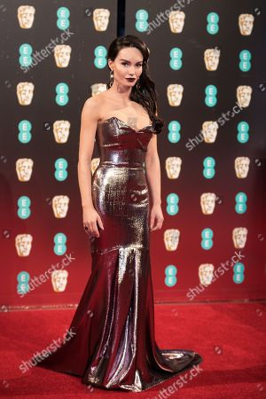 Ava West poses for photographers upon arrival at the BAFTA Film Awards, in London