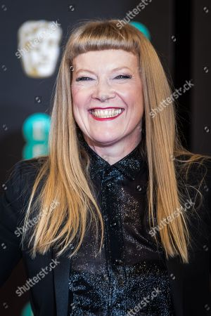 Andrea Arnold poses for photographers upon arrival at the BAFTA Film Awards, in London