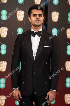 Divian Ladwa poses for photographers upon arrival at the BAFTA Film Awards, in London