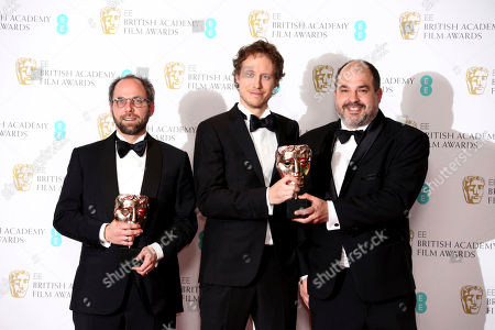 Producer Gabor Sipos, from left, director Laszlo Nemes and producer Gabor Rajna pose with the BAFTA awards for the Best Film Not In The English Language for 'Son of Saul' backstage at the British Academy Film Awards in London