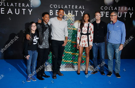 From left, domino artist Lily Hevesh, actors Jacob Latimore, Will Smith, Naomie Harris, Ed Norton and director David Frankel pose for photographers during a photo call for the film 'Collateral Beauty' in London
