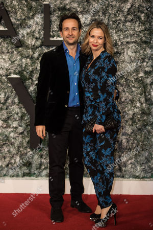 Matt Hermer and Marissa Hermer pose for photographers upon arrival at the premiere of the film 'Collateral Beauty' in London