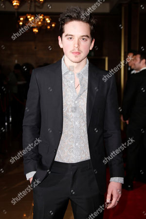 Ferdia Walsh-Peelo poses for photographers upon arrival at the 37th London Critics Circle Film Awards in central London