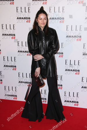 Kym Ellery poses for photographers upon arrival at the Elle Style Awards in London on