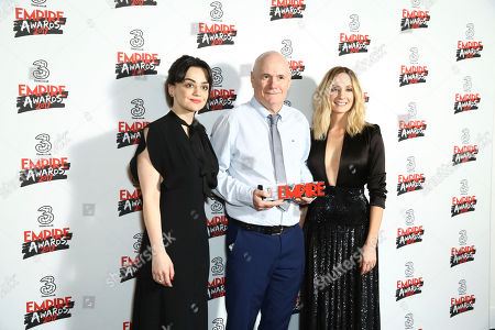 Actors Dave Johns, centre, poses with Hayley Squires, left, and Joanne Froggatt with his Best Male Newcomer Award at the Empire Film awards in London