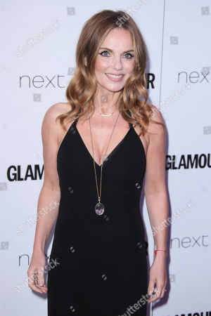 Geri Haliwell poses for photographers upon arrival at the Glamour Woman of the Year Awards in London