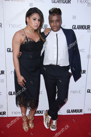 Marlen Esparza, left, and Nicola Adams poses for photographers upon arrival at the Glamour Woman of the Year Awards in London
