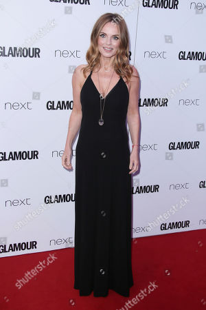 Stock Image of Geri Haliwell poses for photographers upon arrival at the Glamour Woman of the Year Awards in London