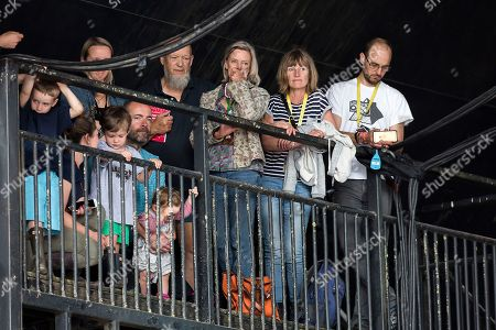 Festival Organisers, including Michael and Emily Eavis, look on as MP Jeremy Corbyn, speaks to the crowd at the Glastonbury Festival at Worthy Farm, in Somerset, England