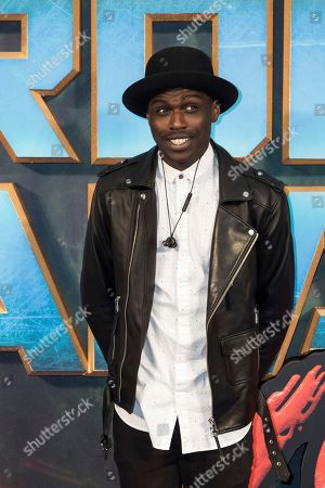 Mo Adeniran poses for photographers upon arrival at the premiere of the film 'Guardians of the Galaxy Vol. 2', in London