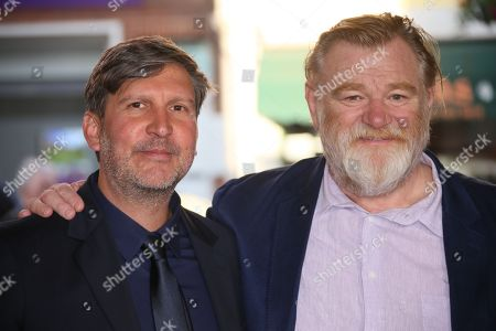 Director Joel Hopkins, left and actor Brendan Gleeson poses for photographers upon arrival at the Hampstead premiere at a north London cinema