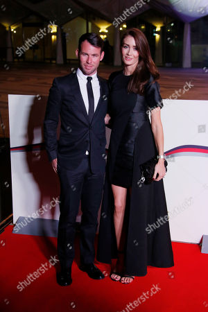 Mark Cavendish and Peta Todd pose for photographers upon arrival at The Sun Military Awards 2016 in London