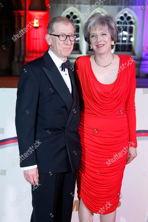 Stock Image of Britain's Prime Minister Theresa May, right, and her husband Philip John May pose for photographers upon arrival at The Sun Military Awards 2016 in London