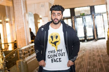 Actor Arjun Kapoor poses for photographers during a photo call to promote the film 'Mubarakan', in London