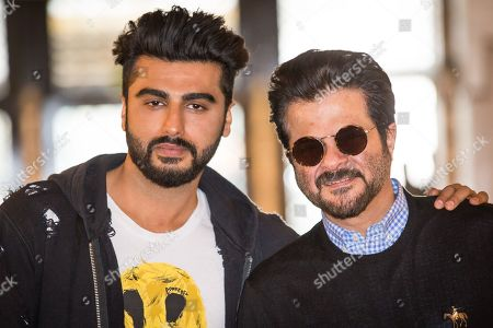 Actors Arjun Kapoor and Anil Kapoor pose for photographers during a photo call to promote the film 'Mubarakan', in London