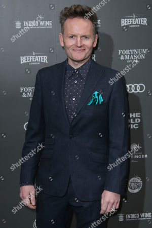 Charlie Fink poses for photographers upon arrival at the Old Vic Gala at the Brewery in east London