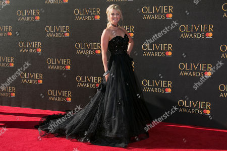 Carley Stenson poses for photographers as she arrives for the Olivier Awards at the Royal Albert Hall in central London